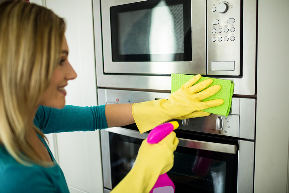 house maid cleaning oven