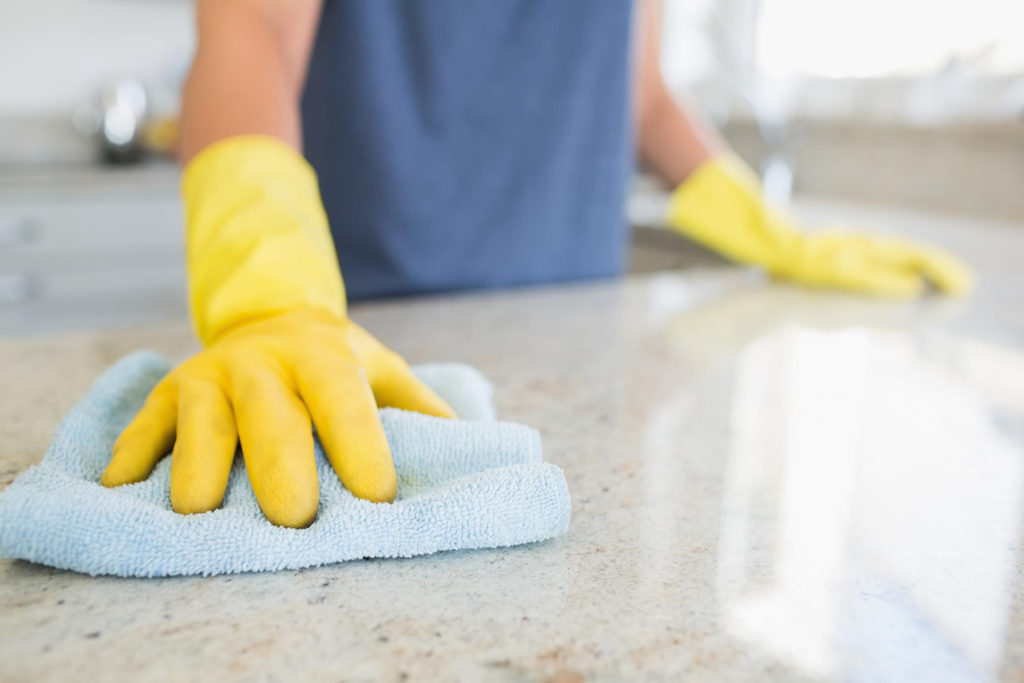 house maid cleaning counter top