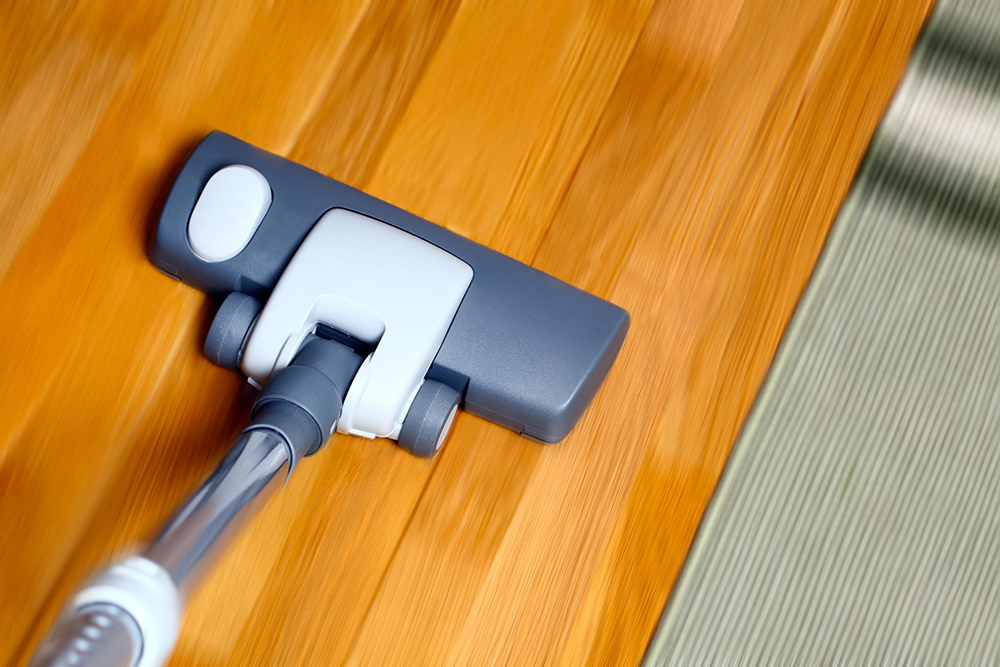 vacuum the wooden floor